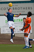 9th July 2019, Dens Park, Dundee, Scotland; Pre-season football friendly, Dundee versus Blackpool; Josh Meekings of Dundee heads clear from Armand Gnanduillet of Blackpool