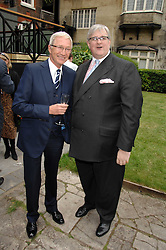 Left to right, PAUL O'GRADY and DAVID MORGAN-HEWITT Managing director The Goring London at a reception for the Friends of The Castle of Mey held at The Goring Hotel, London on 20th May 2008.<br />