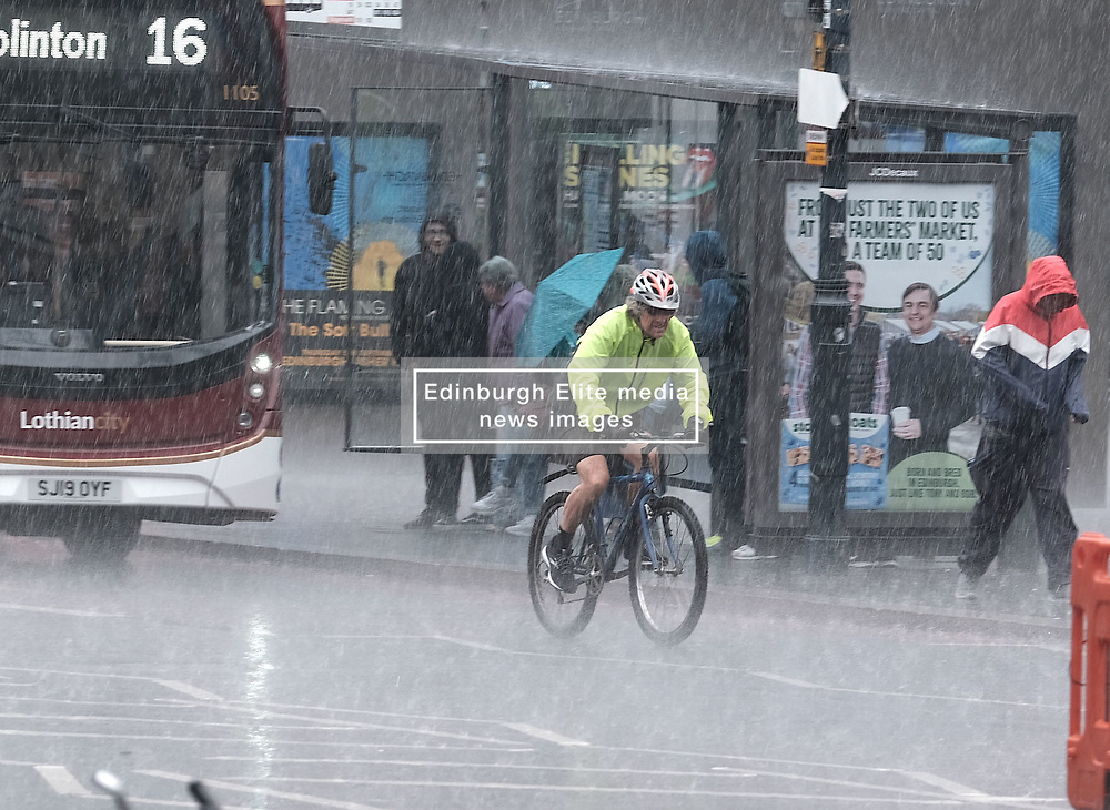 After the really hot weather, Edinburgh was hit by a thundestorm this evening<br /> <br /> Pictured: People in Lothian Road hurry to escape the rain<br /> <br /> Alex Todd   Edinburgh Elite media