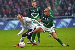 29-01-2011 VOETBAL: WERDER BREMEN - BAYERN MUNCHEN: BREMEN<br /> Mikael SILVESTRE ( Werder #16 ) Arjen Robben (Muenchen #10)<br /> ***NETHERLANDS ONLY***<br /> ©2010- FRH-nph / Frisch