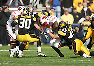 18 OCTOBER 2008: Wisconsin running back P.J. Hill (39) is pulled down by Iowa linebacker Pat Angerer (43) in the first half of an NCAA college football game against Wisconsin, at Kinnick Stadium in Iowa City, Iowa on Saturday Oct. 18, 2008. Iowa won 38-16.