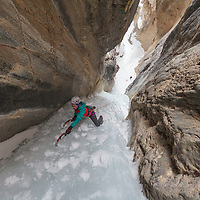 Gemma Wilson climbing End of the Line, WI4 along the David Thompson Highway near Nordegg, Alberta