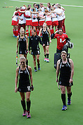 New Zealand players leave the field after losing to England in an extra time penalty shootout during the Black Sticks Women v England Semi Final match at the Glasgow National Hockey Stadium. Glasgow Commonwealth Games 2014. Friday 1 August 2014. Scotland. Photo: Andrew Cornaga/www.Photosport.co.nz