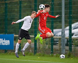NEWPORT, WALES - Monday, October 14, 2019: Wales' captain Morgan Boyes (R) is pushed by Austria's Fabian Tauchhammer during an Under-19's International Friendly match between Wales and Austria at Dragon Park. (Pic by David Rawcliffe/Propaganda)