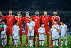 TBILSI, GEORGIA - Friday, October 6, 2017: Wales' Sam Vokes, Ben Davies, Tom Lawrence, Joe Ledley, Chris Gunter and captain Ashley Williams sing the national anthem before the 2018 FIFA World Cup Qualifying Group D match between Georgia and Wales at the Boris Paichadze Dinamo Arena. (Pic by David Rawcliffe/Propaganda)