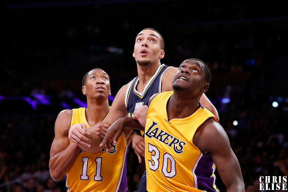 19 October 2014: Utah Jazz center Rudy Gobert (27) vies for the rebound with Los Angeles Lakers forward Wesley Johnson (11) and Los Angeles Lakers forward Julius Randle (30) during the Los Angeles Lakers 98-91 victory over the Utah Jazz, in a preseason game, at the Staples Center, Los Angeles, California, USA.