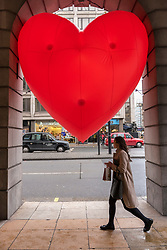 "© Licensed to London News Pictures. 14/02/2018. LONDON, UK. A giant chubby heart balloon is seen at The Ritz Hotel in Piccadilly as part of ""Chubby Hearts Over London"",  a design project conceived by Anya Hindmarch.  Supported by the Mayor of London, the British Fashion Council and the City of Westminster giant chubby heart balloons will be suspended over (and sometimes squashed within) London landmarks as a declaration of love to the city starting on Valentine's Day and continuing throughout London Fashion Week.   Photo credit: Stephen Chung/LNP"