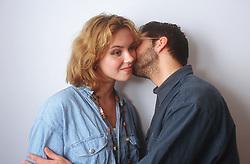 Young man kissing girlfriend's cheek,
