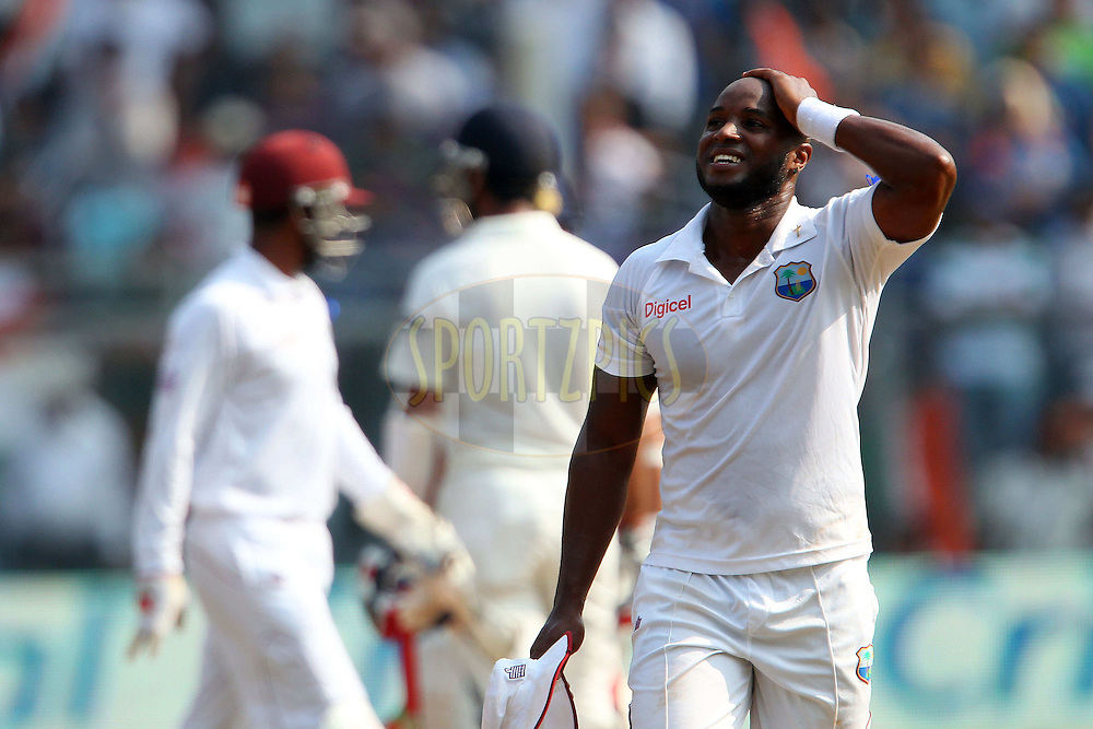 Tino Best of West Indies reacts after a delivery to Sachin Tendulkar of India  during day two of the second Star Sports test match between India and The West Indies held at The Wankhede Stadium in Mumbai, India on the 15th November 2013<br /> <br /> This test match is the 200th test match for Sachin Tendulkar and his last for India.  After a career spanning more than 24yrs Sachin is retiring from cricket and this test match is his last appearance on the field of play.<br /> <br /> <br /> Photo by: Ron Gaunt - BCCI - SPORTZPICS<br /> <br /> Use of this image is subject to the terms and conditions as outlined by the BCCI. These terms can be found by following this link:<br /> <br /> http://sportzpics.photoshelter.com/gallery/BCCI-Image-Terms/G0000ahUVIIEBQ84/C0000whs75.ajndY