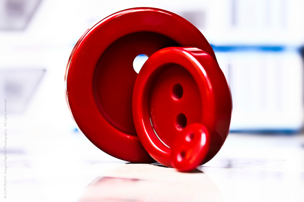 macro image of three different sized red buttons