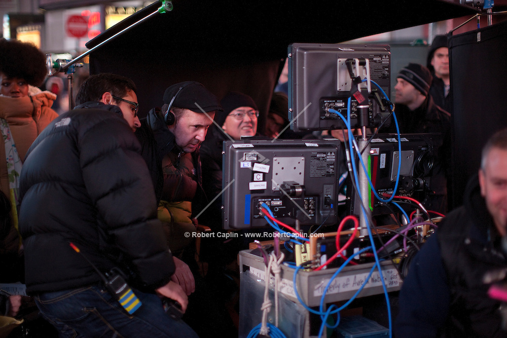 Director Paul McGuigan, center with black hat and headphones, on the set of NBC's new show SMASH in Times Square in New York. Dec 9, 2011...Photo by Robert Caplin.