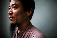 A portrait of Nguyen Quang Trung, a student of traditional medicine and an apprentice of master Dao Kim Long, in Hanoi, Vietnam. Trung quit his high-paying job in the IT sector four years ago to study under master Long after he heard about the elder doctor's ability to cure cancer through traditional methods.