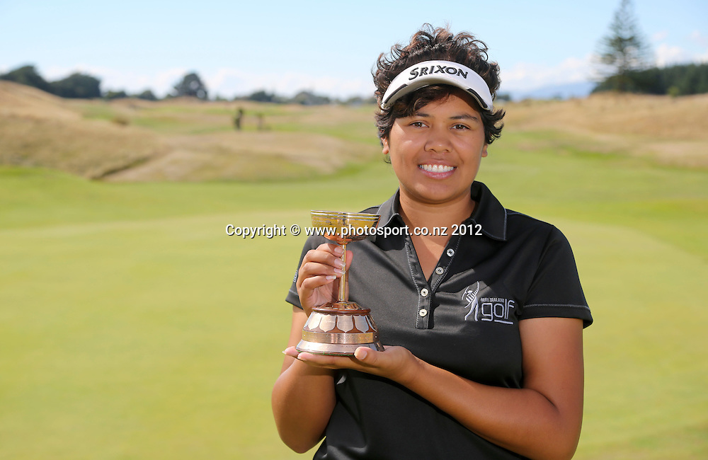 Chantelle Cassidy with the Mellsop Cup after winning on the final day of the New Zealand stroke play championship, Paraparaumu Beach Golf Club, New Zealand. Sunday, 24 March, 2013. Photo: John Cowpland / photosport.co.nz