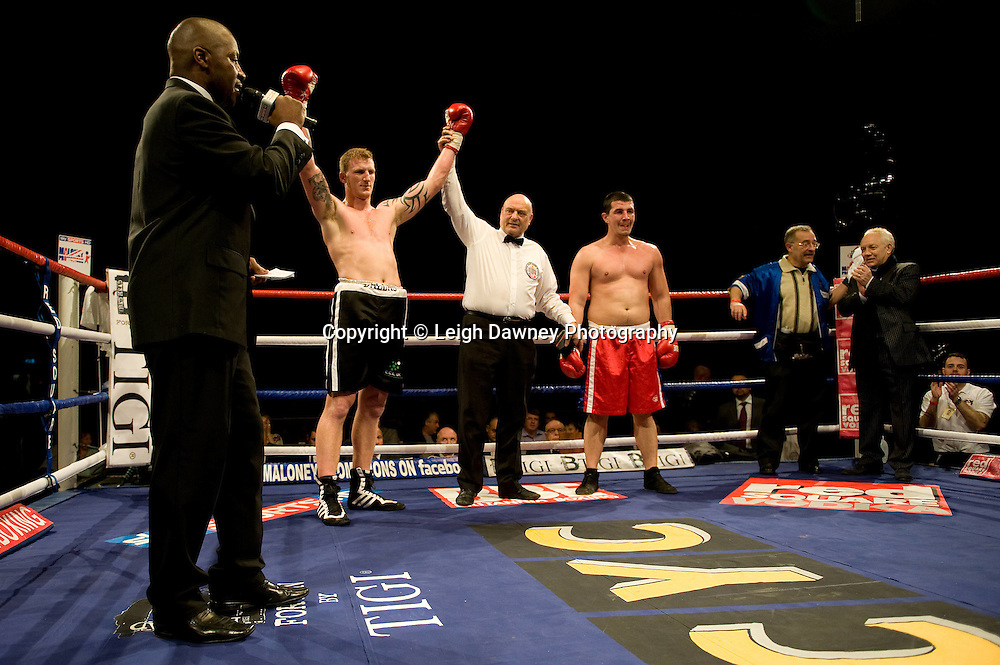 Tom Dallas (black shorts) defeats Yavor Marinchev at Brentwood Centre 22nd January 2010, Frank Maloney Promotions,Credit: © Leigh Dawney Photography