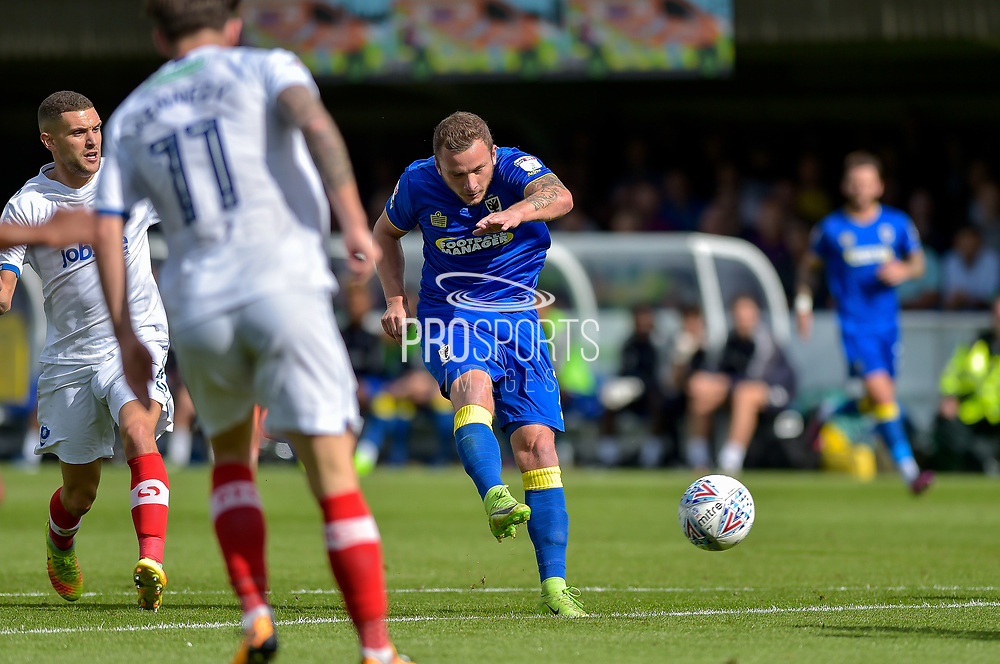 AFC Wimbledon Midfielder, Dean Parrett (18) with a shot at goal during the EFL Sky Bet League 1 match between AFC Wimbledon and Portsmouth at the Cherry Red Records Stadium, Kingston, England on 9 September 2017. Photo by Adam Rivers.