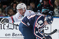 KELOWNA, CANADA - JANUARY 22: Rourke Chartier #14 of Kelowna Rockets checks Parker Bowles #39 of Tri City Americans  on January 22, 2016 at Prospera Place in Kelowna, British Columbia, Canada.  (Photo by Marissa Baecker/Shoot the Breeze)  *** Local Caption *** Rourke Chartier; Parker Bowles;