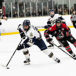 TORONTO, ON - APR 10, 2018: Ontario Junior Hockey League, South West Conference Championship Series. Game seven of the best of seven series between the Georgetown Raiders and the Toronto Patriots, Andrew Petrucci #21 of the Toronto Patriots skates in on a breakaway during the second period.<br /> (Photo by Kevin Raposo / OJHL Images)