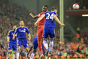 Christian Benteke (Liverpool) wins the header, beating Gary Cahill (Chelsea) and heads it on into the Chelsea penalty box during the Barclays Premier League match between Liverpool and Chelsea at Anfield, Liverpool, England on 11 May 2016. Photo by Mark P Doherty.