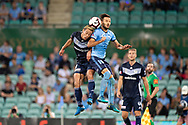SYDNEY, AUSTRALIA - APRIL 06: Sydney FC midfielder Milos Ninkovic (10) and Melbourne Victory midfielder Keisuke Honda (4)  go up for the ball at round 24 of the Hyundai A-League Soccer between Sydney FC and Melbourne Victory on April 06, 2019, at The Sydney Cricket Ground in Sydney, Australia. (Photo by Speed Media/Icon Sportswire)