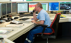 Perry Logothetis, works in the control room at the Solvay SA chemical plant in Antwerp, Belgium, on Thursday, April 22, 2010. Chlorine is the main product produced at Solvay's Antwerp facility.  Solvay SA is the world's largest supplier of Soda Ash or Sodium Carbonate and is also a major producer of caustic soda, hydrogen peroxide, chlorine and fluorinated products. (Photo © Jock Fistick)