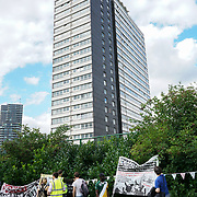 London, UK. 12th August 2017. Focus E15 Mother Ferrier Point, Forty Acre Lane, Canning Town to highlights both unsafe tower blocks with the same cladding as Grenfell Tower. and end at Carpenters Estate to be demolished. Protestors allege Newham Council playing a dirty trick demolish the housing and kick the poor talents far away from where they born in the community to move way for the foreigner's buyer and 1% of the rich.
