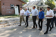 Cedar Rapids City Council member Brian Fagan, US Republican US presidential nominee Senator John McCain (R-AZ), John Smith, owner of CRST, U.S. Republican vice presidential nominee Governor Sarah Palin, and Iowa House Member Kraig Paulsen (R-IA35) (from left) walk down 4th Street and view the damage from the flooding after a campaign rally in Cedar Rapids, Iowa, September 18, 2008.