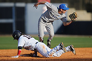 Ole Miss' Jordan King (10) is picked off second base by Memphis Chad Zurcher (2) at Oxford University Stadium in Oxford, Miss. on Tuesday, February 22, 2011.
