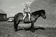 Two boys sitting on a pony 1960s Holland