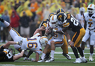 September 3, 2011: Tennessee Tech Golden Eagles running back Adam Urbano (6) is hit by Iowa Hawkeyes defensive back Shaun Prater (28) during the first half of the game between the Tennessee Tech Golden Eagles and the Iowa Hawkeyes at Kinnick Stadium in Iowa City, Iowa on Saturday, September 3, 2011. Iowa defeated Tennessee Tech 34-7 in a game stopped at one point due to lightning and rain.