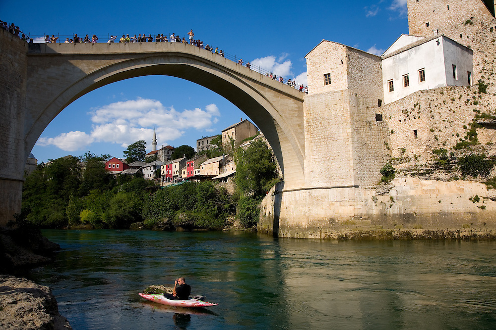 Famous bridge jumpers (Mostari) leaping from Stari Most (Old Bridge) in Mostar, Bosnia and Herzegovina. The bridge is a world heritage site which was destroyed during the Bosnian war in 1993. The river below is the Neretva...Scenes from Mostar, Bosnia and Herzegovina.