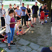 "YARMOUTH, Maine- 8/13/17 -- Janice Cooper, (D-Yarmouth) Maine State Representative for District 17, speaks to a group of about  40 people who gathered on the Yarmouth town green and marched together singing ""We Shall Overcome"" on Sunday night to demonstrate solidarity with the victims of weekend violence in Charlottesville, Va which killed three and injured dozens. Photo by Roger S. Duncan for The Forecaster."