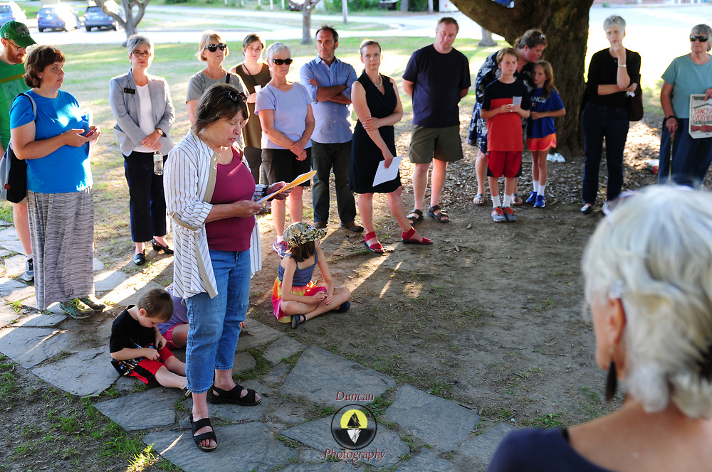 """YARMOUTH, Maine- 8/13/17 -- Janice Cooper, (D-Yarmouth) Maine State Representative for District 17, speaks to a group of about  40 people who gathered on the Yarmouth town green and marched together singing """"We Shall Overcome"""" on Sunday night to demonstrate solidarity with the victims of weekend violence in Charlottesville, Va which killed three and injured dozens. Photo by Roger S. Duncan for The Forecaster."""