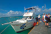 MEXICO, YUCATAN, COZUMEL scuba divers on boat to Palancar Reef