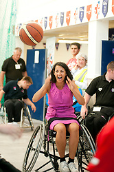 Cadbury 2012 Paralympic demonstration Sheffield..Amera Muthana Kraft Quality Manager tries her hand at wheelchair basketball with the  RGK Rhinos Sporting club wheelchair basketball team to give Sheffield colleagues an insight into Wheelchair basketball, Paralympic sports and promote awareness around the different sporting disciplines.   .  ....3 September 2012.Image © Paul David Drabble