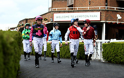 General view of jockey's walking into the parade ring before the Matchbook Betting Podcast Rosebery Handicap during the Easter Family Fun Day at Kempton Park Racecourse.