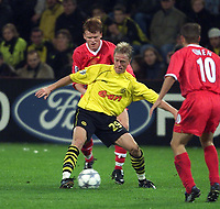 Liverpool's John Arne Riise and Dortmund's Jan Sorensen during the UEFA Champions League match at the Westfalenstadion.