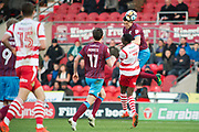 Scunthorpe United defender Murray Wallace (5) heads the bsall during the The FA Cup match between Doncaster Rovers and Scunthorpe United at the Keepmoat Stadium, Doncaster, England on 3 December 2017. Photo by Craig Zadoroznyj.