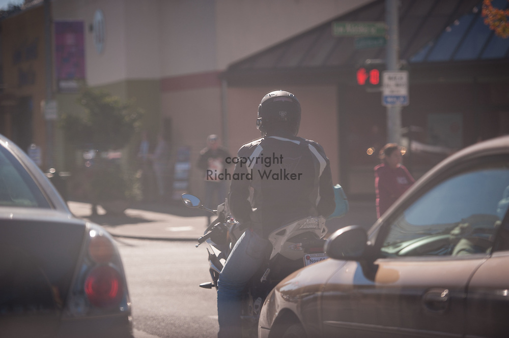 2016 October 11 - Motorcyclist and cars at Alaska Junction, West Seattle , Seattle, WA, USA. By Richard Walker