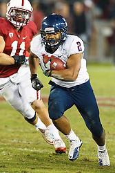 November 6, 2010; Stanford, CA, USA;  Arizona Wildcats running back Keola Antolin (2) rushes past Stanford Cardinal linebacker Shayne Skov (11) during the third quarter at Stanford Stadium.  Stanford defeated Arizona 42-17.
