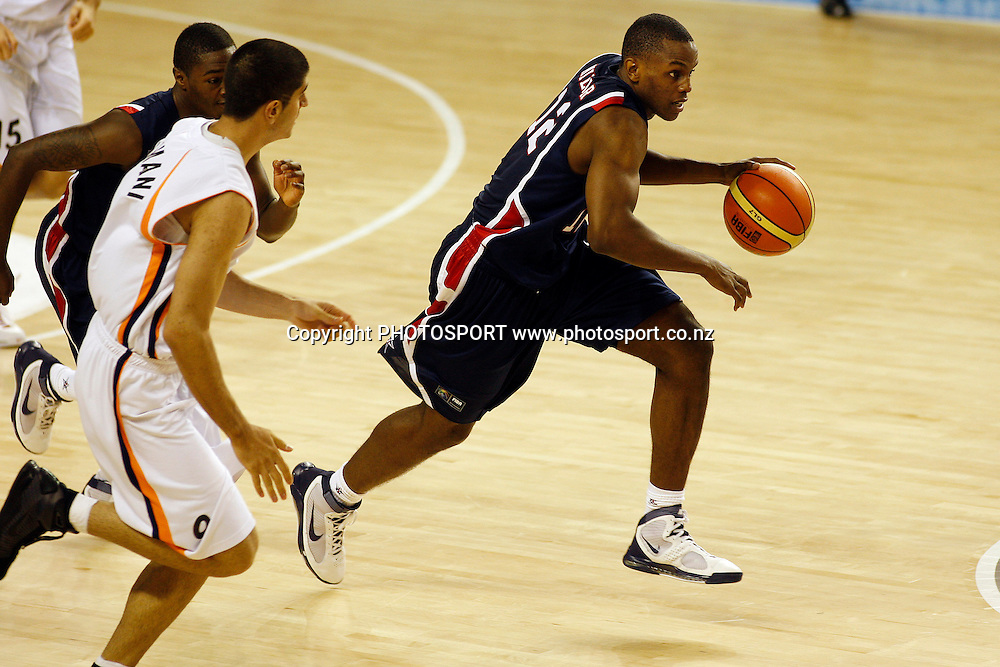 USA Forward Darius Miller takes the ball forward during the USA's 106-55 victory over Iran.<br />