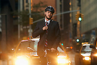 Man standing by bicycle in street portrait