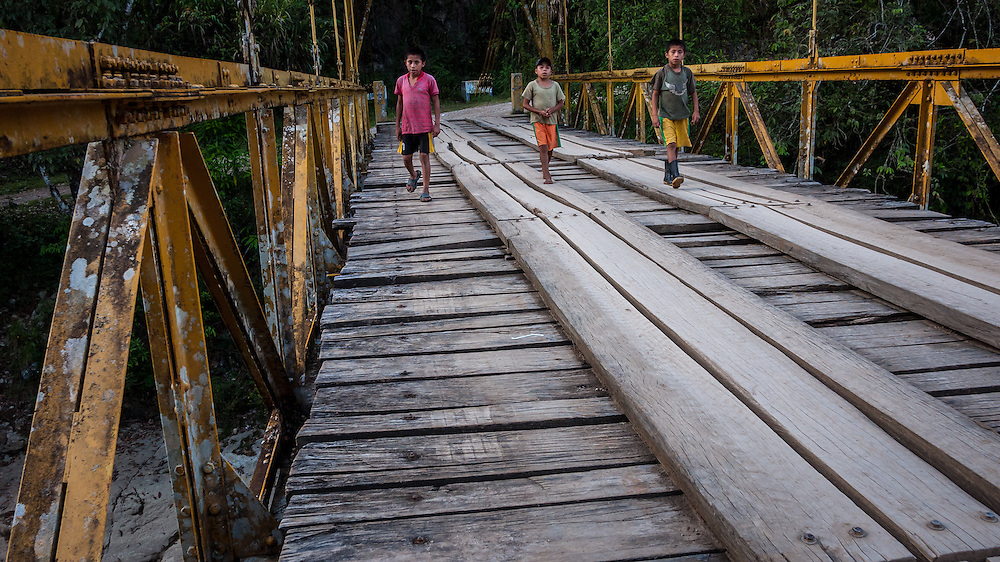 boys on a bridge in Guatemala
