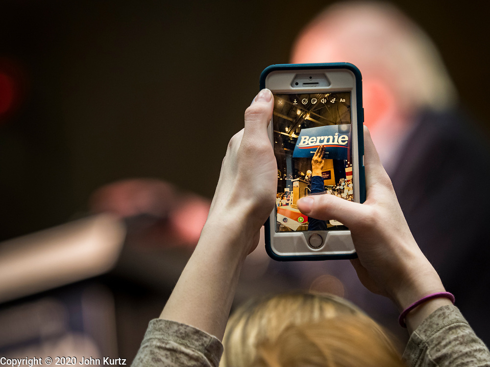 02 MARCH 2020 - ST. PAUL, MINNESOTA: A person uses a smart phone to photograph US Senator Bernie Sanders at a Sanders Get Out the Vote rally in the RiverCentre in St. Paul. More than 8,400 people attended the rally. Minnesota is a Super Tuesday state this year and Minnesotans will go to the polls Tuesday. Minnesota Sen. Amy Klobuchar was expected to win her home state, but she dropped out early Monday, March 2.         PHOTO BY JACK KURTZ