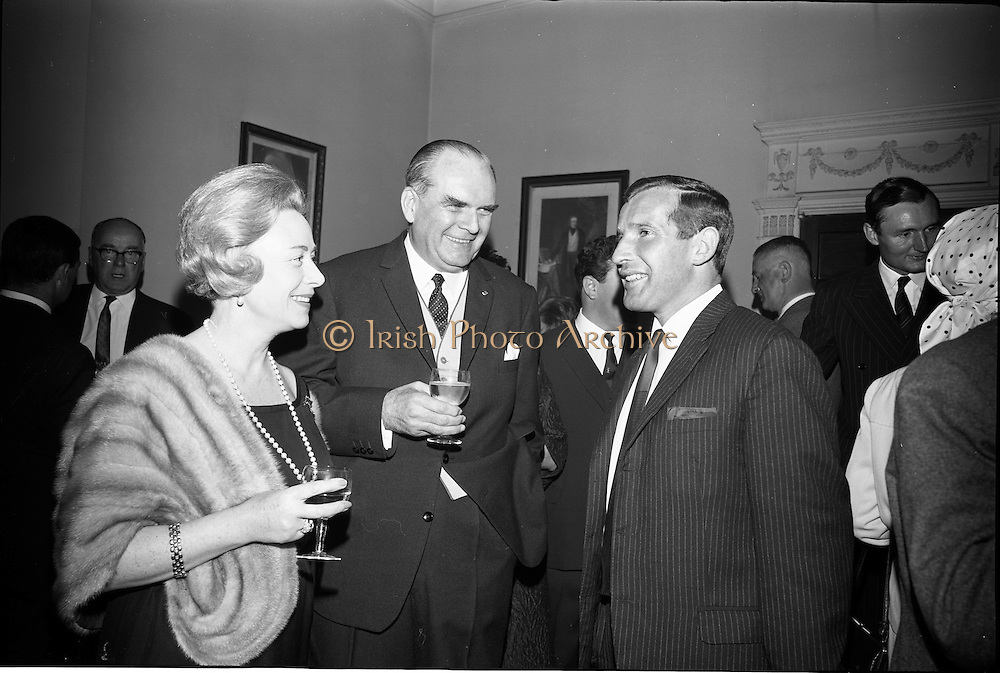 24/06/1965<br /> 06/24/1965<br /> 24 June 1965<br /> Gilbeys Ireland Ltd. reception at Gilbey's Wine Merchants, Nos. 46-49 O'Connell St., Dublin, for the presentation of a consignment of Dry Monopole Champagne to the organisers of Le Bal des Petits Lits Blancs. Image shows the French Ambassador to Ireland, His Excellency M. Roger du Gardier (centre) and Madam du Gardier with Mr Ian Cairnduff, Director, Gilbeys of Ireland Ltd at the reception.