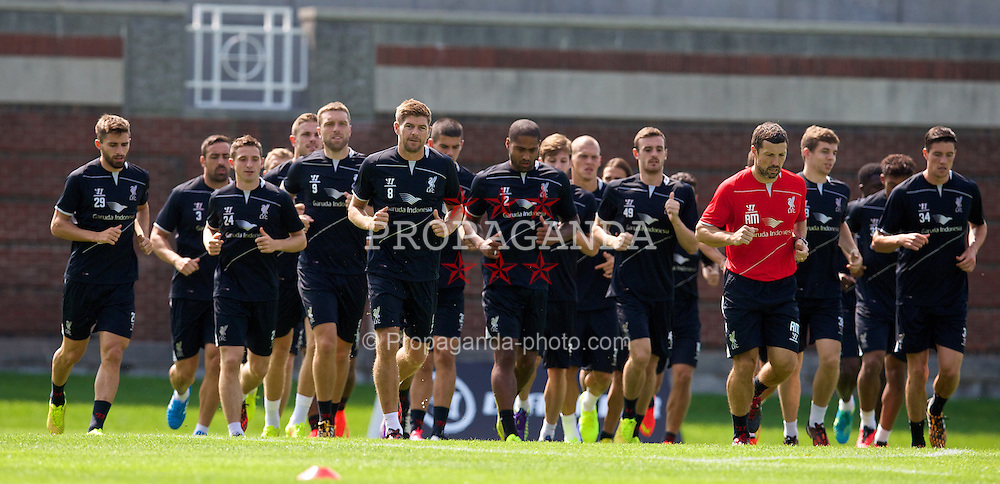 HARVARD, USA - Monday, July 21, 2014: Liverpool's captain Steven Gerrard leads his players during a preseason training session at the Harvard Stadium in Boston on day one of their USA Tour. (Pic by David Rawcliffe/Propaganda)