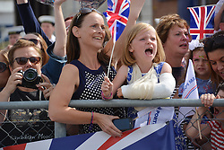Caitlin Leafe, 6, and her mother Katrina Leafe, 36, from Wetherby, West Yorkshire, wave home Katrina's brother Lieutenant Rod Milne, as he arrives on board HMS St Albans at Portsmouth Naval Base following a nine-month deployment to the Middle East.