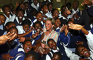 Princess Astrid of Belgium, has fun with students that are involved in the TAC eduaction programin in the Khayelitsha Township of Cape Town, South Africa, on Thursday, April 29, 2004. There are about 500,000 people living in Khayelitsha and 10% of the population is infected with HIV / AIDS. (Photo © Jock Fistick)