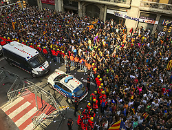 October 3, 2017 - Barcelona, Catalonia, Spain - Hundreds of thousand of catalan marched for the street of Barcellona to  protest against the violence of the Guardia Civil  to prevent the referendum vote on October 03, 2017 in Barcelona. .The general strike paralyzed the transport of the city..The protesters shout slogans and gesture toward the police officers in front of  the building of General Direction of the National Police of Spain and in front of the building of Spanish Government..The catalan police the ''Mossos'' toghether with firemen prevented that the protest degenerate. (Credit Image: © Mauro Ujetto/NurPhoto via ZUMA Press)