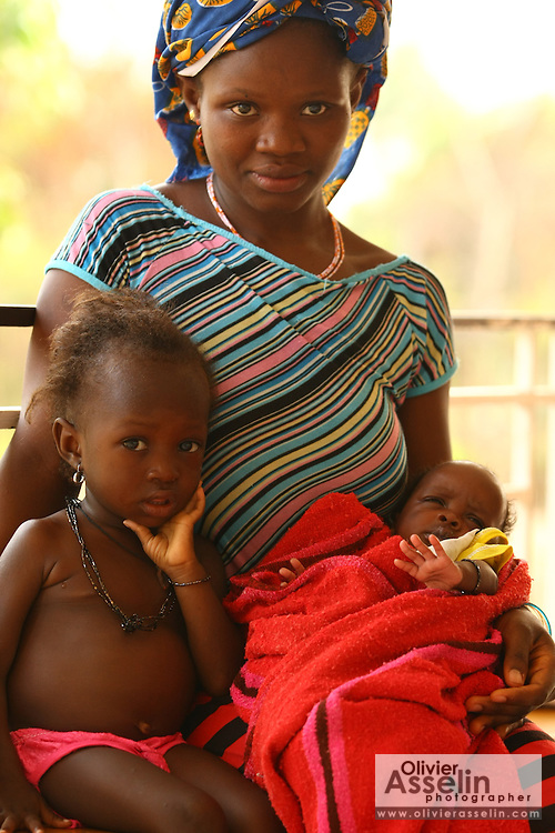 Mariatu Kargbo, 18, with her children Kadiatu, 3, and Baimba, 3 months old, at the therapeutic feeding center of the Magbenthe hospital in Makeni, Sierra Leone on Thursday February 26, 2009. UNICEF sponsored some of the construction of the hospital facilities, and also provides high-protein biscuits and milk as part of a joint effort with the World Food Programme...