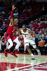 NORMAL, IL - December 18: Dedric Boyd drives the baseline defended by Michael Diggins during a college basketball game between the ISU Redbirds and the UIC Flames on December 18 2019 at Redbird Arena in Normal, IL. (Photo by Alan Look)